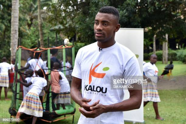 Ivorian football player Salomon Kalou talks to journalists during a Christmas event for orphans in Abidjan on December 22 2017 The Kalou Foundation...