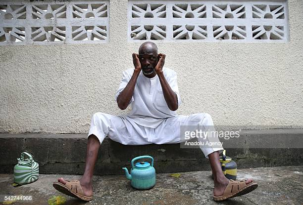 Ivorian man performs an ablution before he was worshiping during the holy month of Ramadan in Abidjan, Ivory Coast on June 24, 2016.