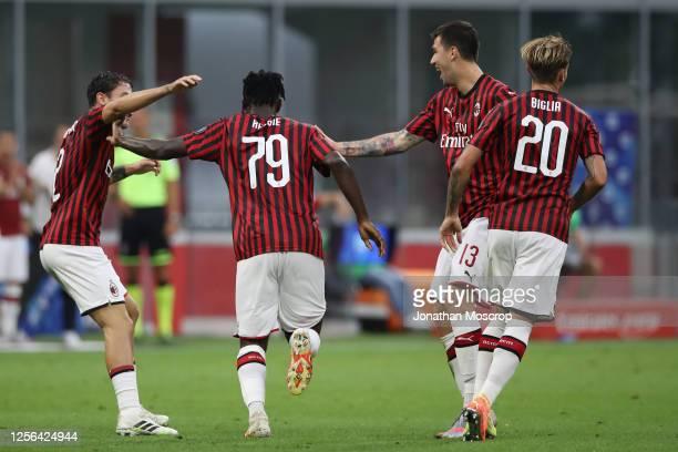 Ivorian midfielder Franck Kessie of AC Milan celebrates with team mates Italian defenders Davide Calabria and Alessio Romagnoli and Argentinian...
