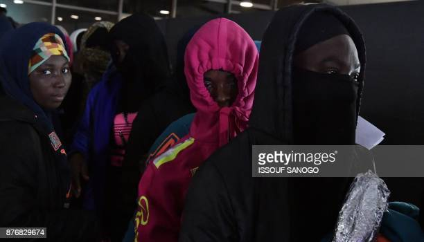 Ivorian migrants returning from Libya to be repatriated in their country arrive at the airport of Abidjan on November 20 2017 Ivorian migrants...
