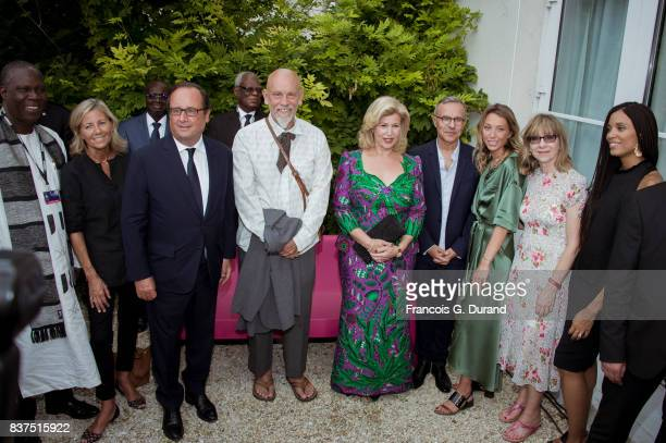 Ivorian Minister of Culture Maurice Kouakou Bandaman, French journalist Claire Chazal, former French president Francois Hollande, Ivory Coast's wife...