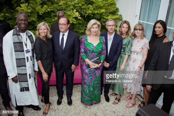 Ivorian Minister of Culture Maurice Kouakou Bandaman French journalist Claire Chazal former French president Francois Hollande Ivory Coast's wife...
