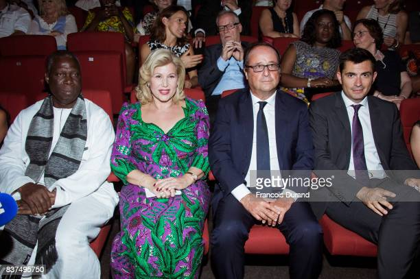 Ivorian Minister of Culture Maurice Kouakou Bandaman Ivory Coast's wife Dominique Ouattara former French president Francois Hollande and Moyor of...