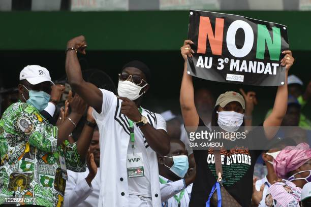 Ivorian MP Yasmina Ouegnin holds a banner reading No to third term during a meeting against the candidacy for reelection of the incumbent president...