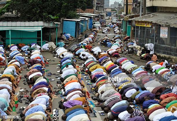 Ivorian Muslims pray in the street in the Adjame neighborhood of Abidjan on August 30 celebrating the start of the threeday Eid alFitr feast...