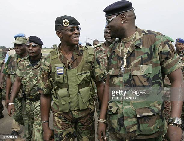 Ivorian national army chief of staff colonel Philippe Mangou speaks with Ivorian rebel New Forces deputy chief of staff Ouattara Issiaka aka Watao...