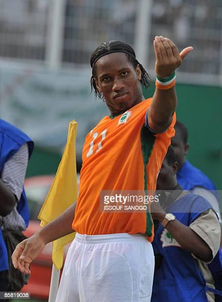 Ivorian National football team 'Elephants' striker Didier Drogba celebrates a goal against Malawi on March 29 2009 at Felix HouphouetBoigny stadium...