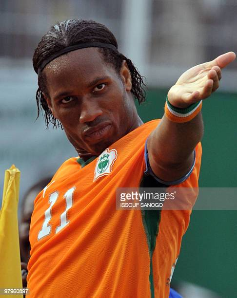 Ivorian National football team 'Elephants' striker Didier Drogba celebrates a goal against Malawi on March 29 2009 at Felix HouphouetBoigny stadium...