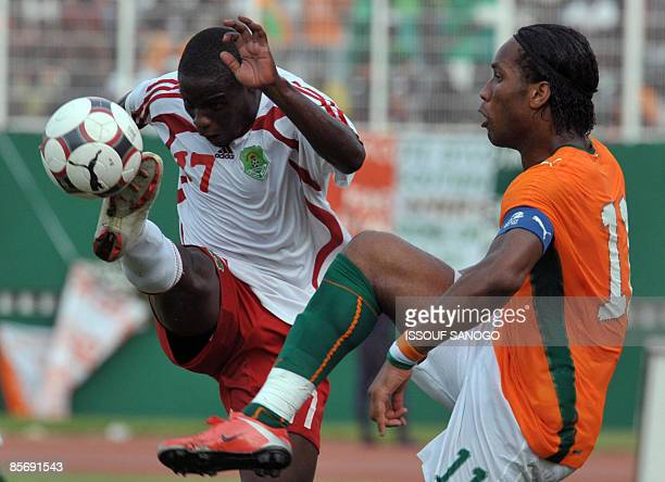 Ivorian National football team 'Elephants' striker Didier Drogba duels for the ball wtih Malawi player Jmmy Zakazaka on March 29 2009 at Felix...