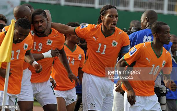 Ivorian National football team 'Elephants' striker Didier Drogba celebrates with teammate victory against Malawi on March 29 2009 at Felix...