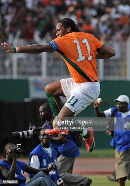 Ivorian National football team nicknamed the Elephants striker Didier Drogba celebrates a goal against Malawi on March 29 2009 at the Felix...
