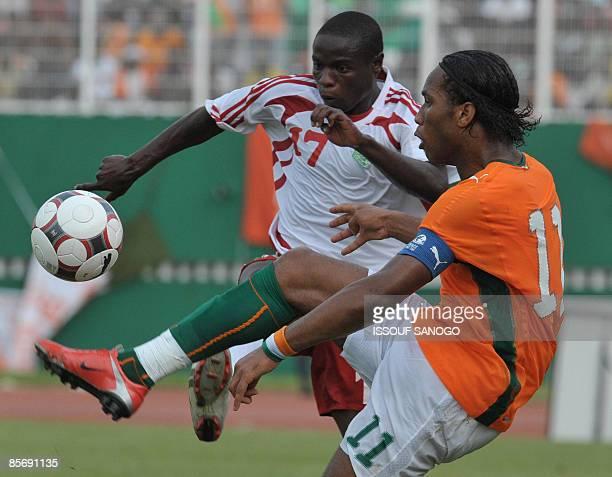 Ivorian National football team nicknamed 'the Elephants' striker Didier Drogba vies with Malawian player Jmmy Zakazaka March 29 2009 at the Felix...