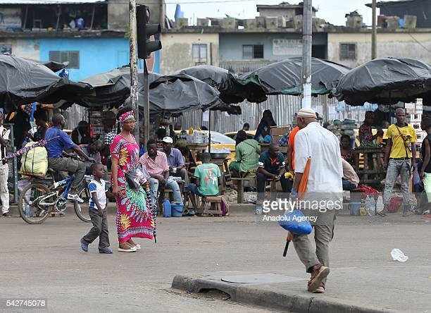 Ivorian people purchase their needs at the bazaar on the main street of the city as Ivorian people live under difficult living conditions due to low...
