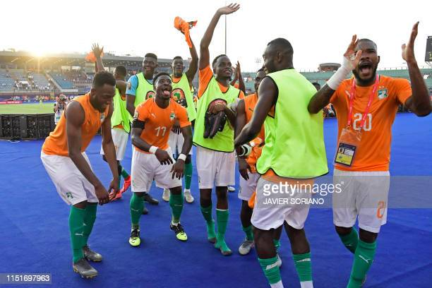 Ivorian players celebrate after winning the 2019 Africa Cup of Nations football match between Ivory Coast and South Africa at the Al Salam Stadium in...