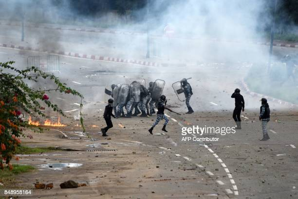 Ivorian police officers clash with students during a demonstration against rising education costs at the Felix Houphouet Boigny University on...