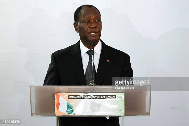 Ivorian President Alassane Ouattara addresses a ceremony at the presidential palace in Abidjan on August 4 2015 to launch a compensation program for...