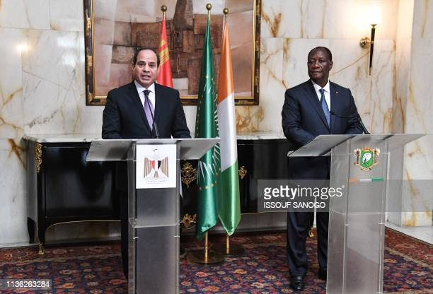 Ivorian President Alassane Ouattara and Egyptian President and African Union Chairman Abdel Fattah al-Sisi give a joint press conference at the...