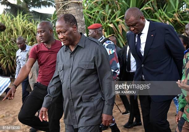 Ivorian president Alassane Ouattara and Ivorian Interior minister Ahmed Bakayoko visit the beach resort of GrandBassam after gunmen went on a...