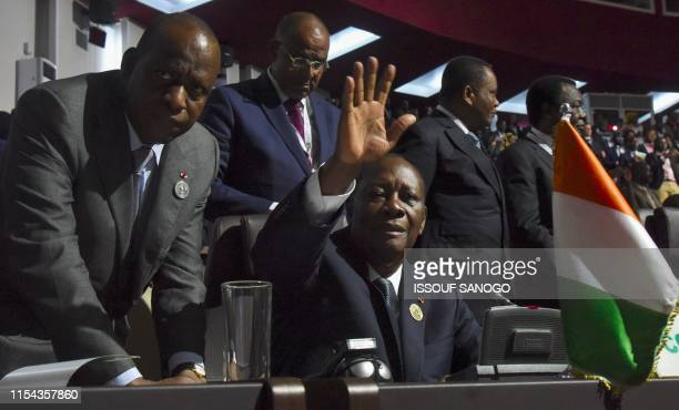 Ivorian President Alassane Ouattara and Ivory Coast Minister for African integration Ally Coulibaly attend the opening ceremony of the African Union...