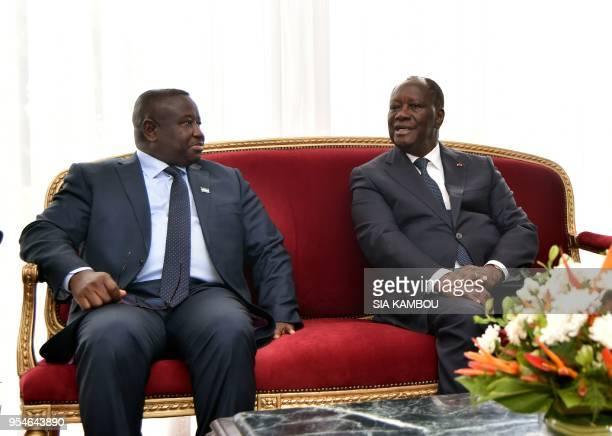 Ivorian President Alassane Ouattara and Sierra Leone president Julius Maada Bio hold a meeting on May 4, 2018 at the presidentaial palace in Abidjan.
