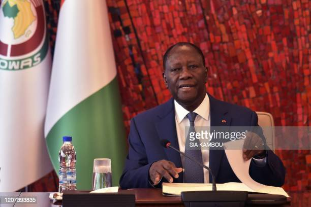 Ivorian President Alassane Ouattara attends a meeting of the National Security Council at the Presidential Palace in Abidjan following the outbreak...