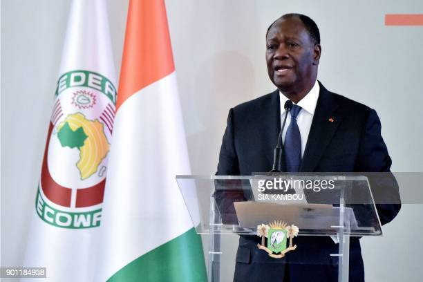 Ivorian President Alassane Ouattara delivers his New Year wishes at the presidential palace in Abidjan on January 4 2018 / AFP PHOTO / SIA KAMBOU