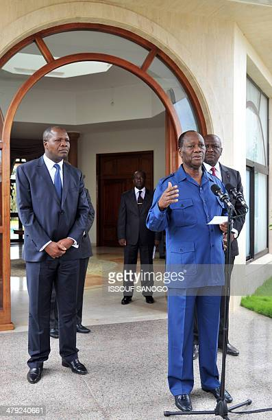 Ivorian President Alassane Ouattara gives a press conference flanked by Interior and Security minister Hamed Bakayoko and Development minister Albert...