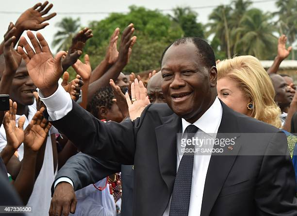 Ivorian president Alassane Ouattara waves to supportsers during the inauguration of the Philippe Gregoire Yace bridge on March 21 2015 in Jacqueville...