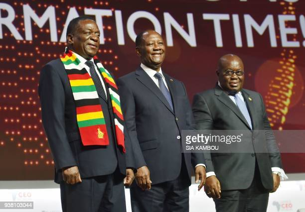 Ivorian President Alassane Ouattara Zimbabwe's President Emmerson Mnangagwa Ghanaian President Nana AkufoAddo pose at the end of the opening session...