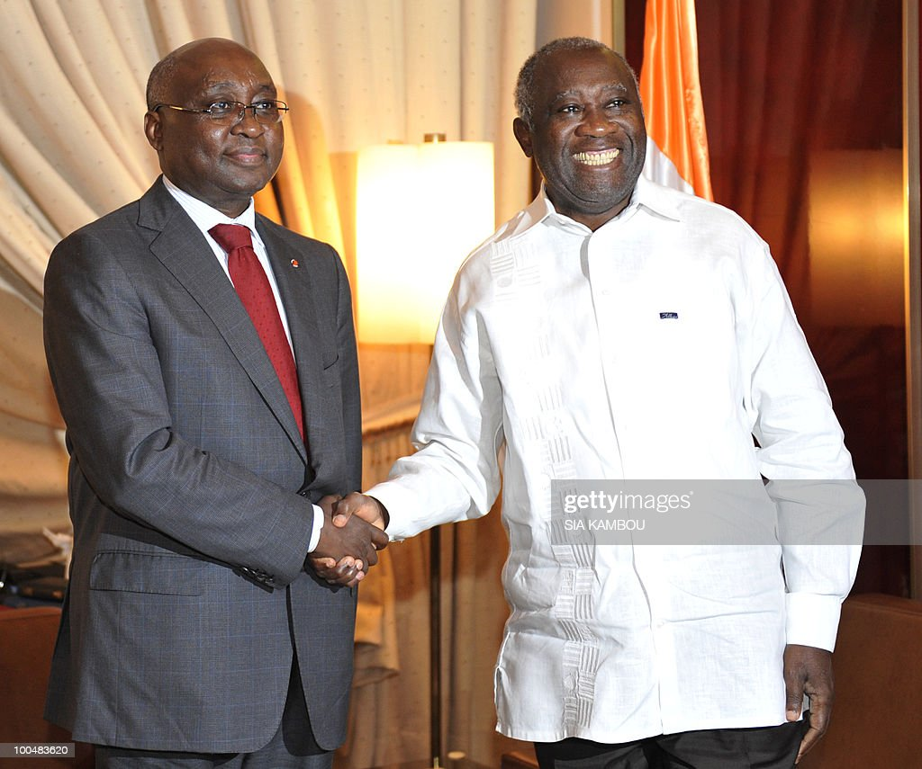 Ivorian President Laurent Gbagbo (R) shakes hands with Donald Kaberuka, the president of the African Development Bank (L) on May 24, 2010 at the Presidential Palace in Abidjan before their talks focused on the African Development Bank annual meetings due to be held on May 27 and 28, 2010 in Abidjan.