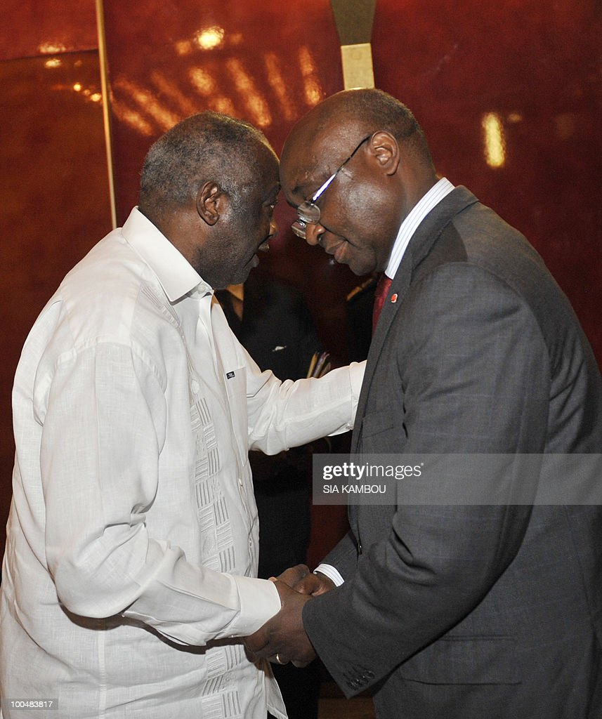 Ivorian President Laurent Gbagbo (L) shakes hands with Donald Kaberuka, the president of the African Development Bank (R) on May 24, 2010 at the Presidential Palace in Abidjan before their talks focused on the African Development Bank annual meetings due to be held on May 27 and 28, 2010 in Abidjan.