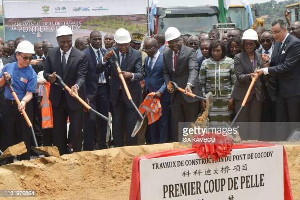 Ivorian Prime Minister Amadou Gon Coulibaly and Equipment and Road Maintenance minister Amede Koffi Kouakou attend on March 22 2019 the official...