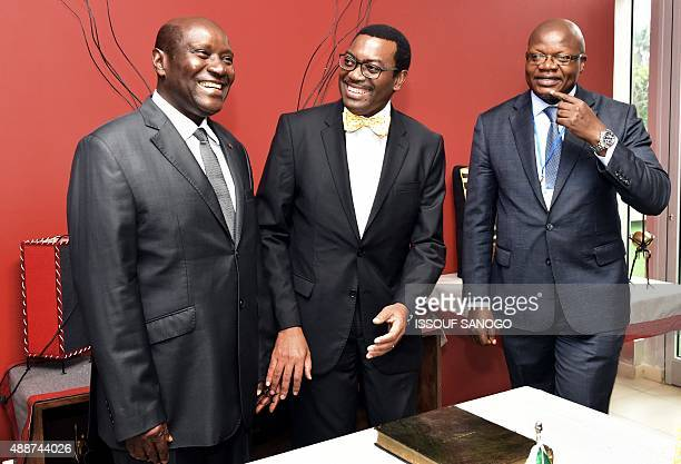 Ivorian Prime Minister Daniel Kablan Duncan sits next to Akinwumi Adesina president of the African Development Bank and Ivorian Minister of Petroleum...