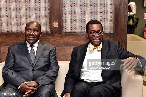Ivorian Prime Minister Daniel Kablan Duncan sits next to Akinwumi Adesina president of the African Development Bank on September 17 2015 before...