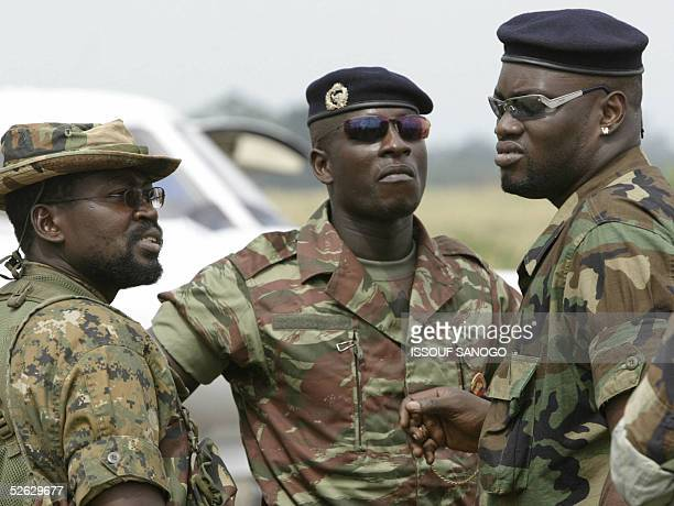 Ivorian rebel New Forces leaders Ouattara Morou, Sherif Ousmane and Watao wait, 14 April 2005 at Bouake airport prior the first meeting between...