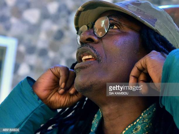 Ivorian reggae Alpha Blondy gestures during an interview at his radio station Alpha Blondy FM in Abidjan on March 17 2015 AFP PHOTO/ SIA KAMBOU