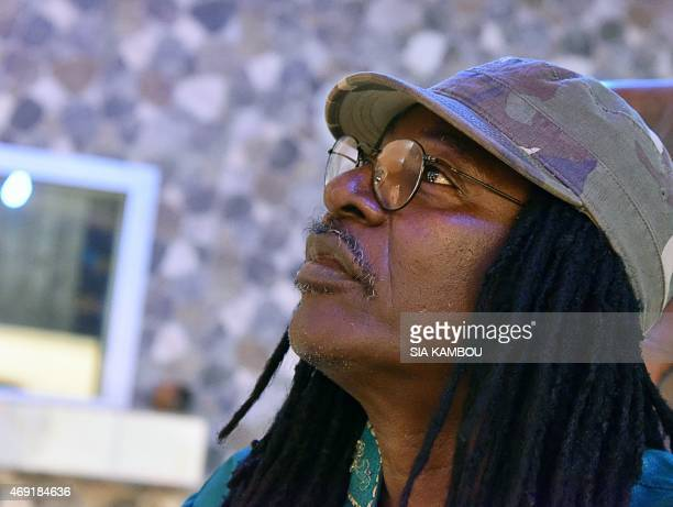 Ivorian reggae Alpha Blondy looks on during an interview at his radio station Alpha Blondy FM in Abidjan on March 17, 2015. AFP PHOTO/ SIA KAMBOU
