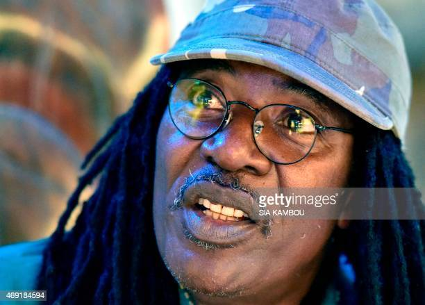Ivorian reggae Alpha Blondy speaks during an interview at his radio station Alpha Blondy FM in Abidjan on March 17, 2015. AFP PHOTO/ SIA KAMBOU