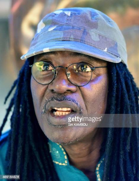 Ivorian reggae Alpha Blondy speaks during an interview at his radio station Alpha Blondy FM in Abidjan on March 17 2015 AFP PHOTO/ SIA KAMBOU