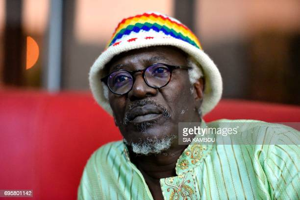 Ivorian reggae singer Alpha Blondy looks on during a an interview in Abidjan on June 14 2017 / AFP PHOTO / Sia KAMBOU