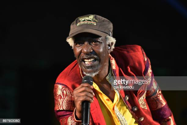 Ivorian reggae singer Seydou Kone aka Alpha Blondy performs during a concert at the Felix Houphouet Boigny University in Abidjan on December 23 2017...