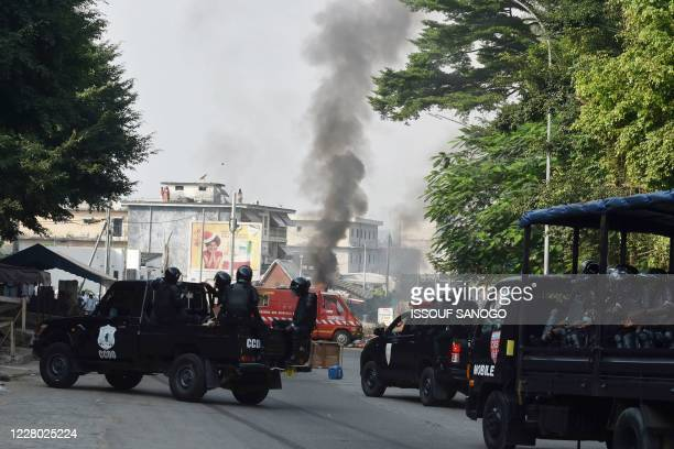 Ivorian riot Police arrive to disperse demonstrators during a protest against the third term of Ivory Coast President Alassane Ouattara in the...