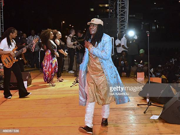 Ivorian singer Alpha Blondy performs on March 14 2015 in the palais de la culture in Abidjan during a free concert to celebrate the artist's radio...
