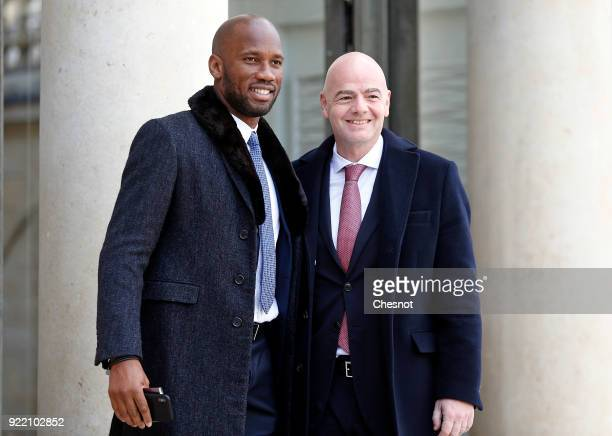 Ivorian soccer player Didier Drogba and FIFA President Gianni Infantino pose upon their arrival at the Elysee Palace to attend a lunch meeting with...