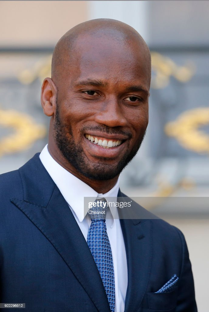 Ivorian soccer player Didier Drogba leaves the Elysee Palace after a lunch with French President Emmanuel Macron and Liberia's recently-elected President George Weah on February 21, 2018 in Paris, France. Weah is on two days official visit in France.