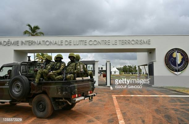 Ivorian soldiers are seen during the inauguration of the International Academy for Combating Terrorism in Jacqueville in Ivory Coast on June 10,...