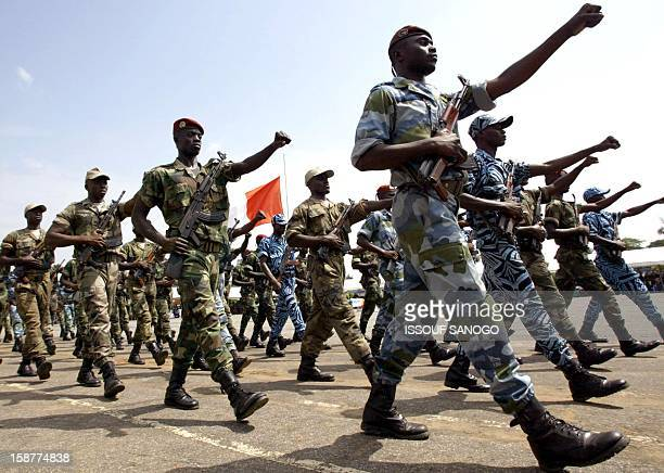 Ivorian soldiers march 15 November 2003 at gendarmerie school in Abidjan, during ceremony in honour of soldiers killed since September 2002 in the...