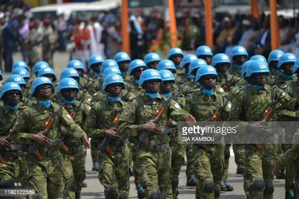 Ivorian soldiers of the UN peacekeeping mission in Mali MINUSMA parade as they take part in the celebrations marking the 59th anniversary of Ivory...