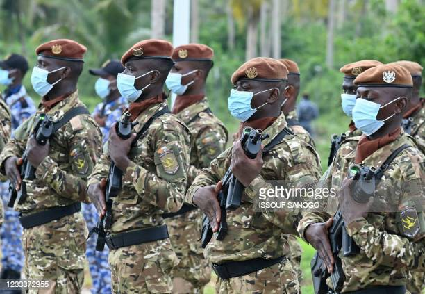 Ivorian soldiers take part in the inauguration of the International Academy for Combating Terrorism in Jacqueville in Ivory Coast on June 10, 2021. -...