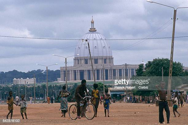 Ivorians near Our Lady of Peace Basilica. The basilica was consecrated by Pope John Paul II.